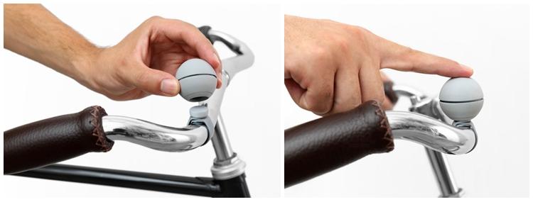 依靠磁力相吸而固定,但不会轻易脱离底座。轻按车铃顶部即可触发铃声,共有三款铃音可供选择.jpg